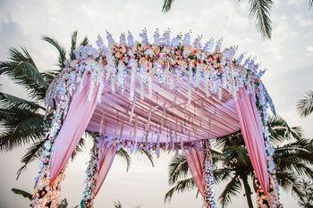 Circular mandap decor with florals and light pink fabric