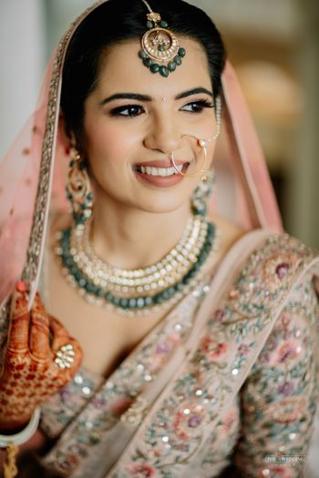Bride holding her dupatta and posing.