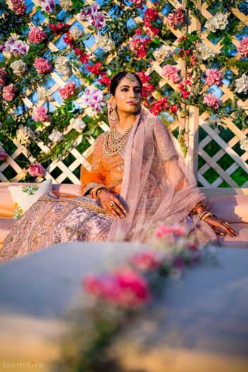 Photo of wedding day bridal portrait in light peach lehenga