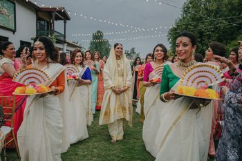 Photo of Bride entering with her coordinated bridesmaids.
