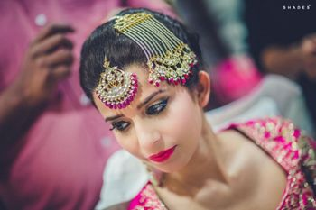 Photo of Hot Pink Bridal Jewelry and Makeup