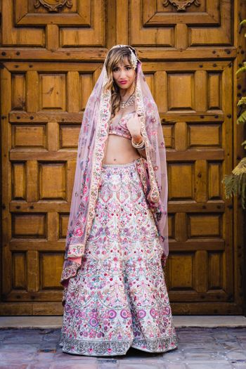 Floral embroidery lehenga with bride in open hair