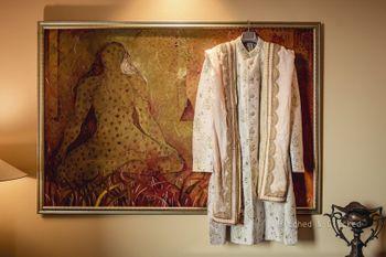 pastel sherwani on hanger with stole