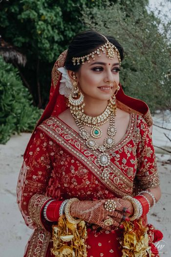 bridal look with simple makeup and layered jewellery