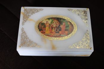 Photo of white and gold box  invite