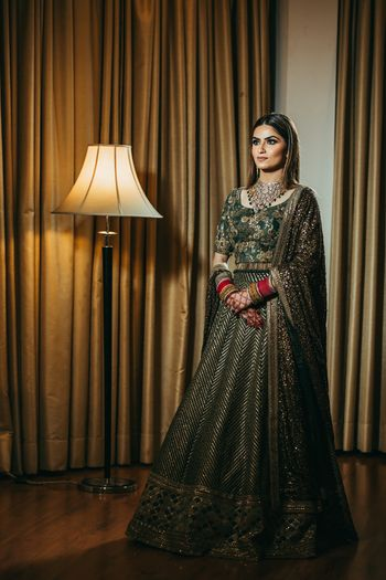A bride in a shimmery grey lehenga for her reception
