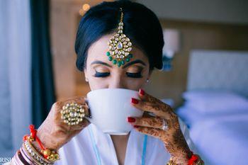 Bride drinking coffee getting ready shot idea