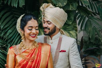 Bright and happy couple shot with both in contrasting outfits
