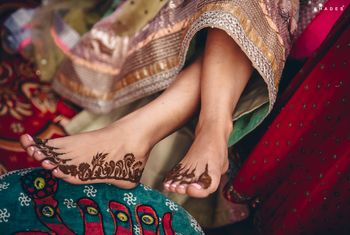 Photo of Unique and minimalistic feet mehndi design.