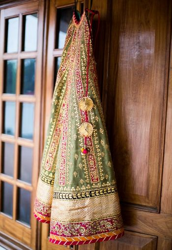 Olive green lehenga with gota patti work