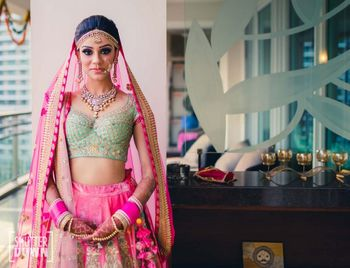 Photo of Bright pink and mint bridal lehenga with unique blouse design