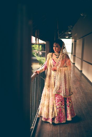 Photo of gold and pink anarkali