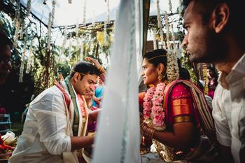 Photo of South indian nuptials with the couple divided by a sheet
