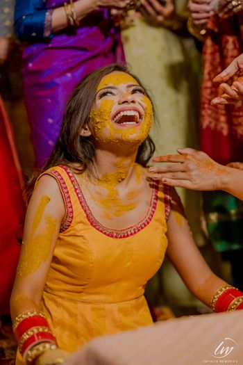 A bride laughs during her haldi ceremony