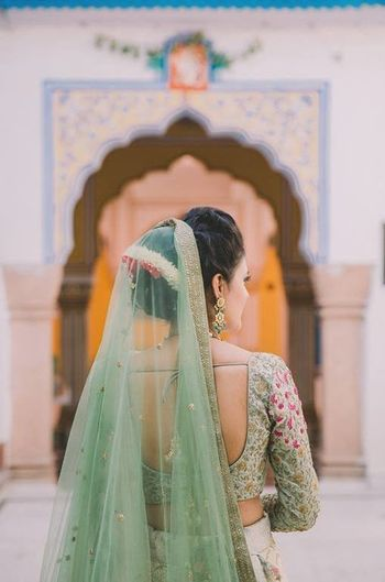 Photo of Bride back shot in offbeat bridal colour