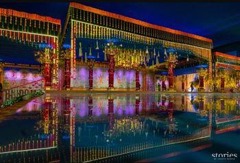 Photo of Grand Mandapam decor with gajras, bells and genda phool.
