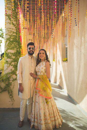 Photo of Summer mehendi bride and groom portrait