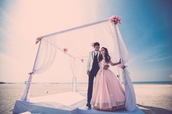 Beach wedding with white mandap