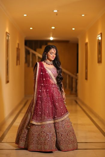 Photo of Embroidered maroon and gold lehenga