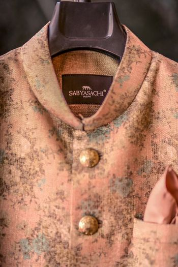 Photo of Peach sabyasacghi sherwani on hanger
