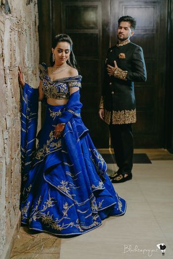 Royal blue layered lehenga with off shoulder blouse