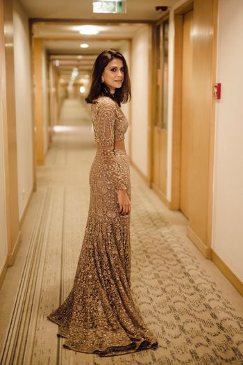 Gold cocktail gown with sequin work