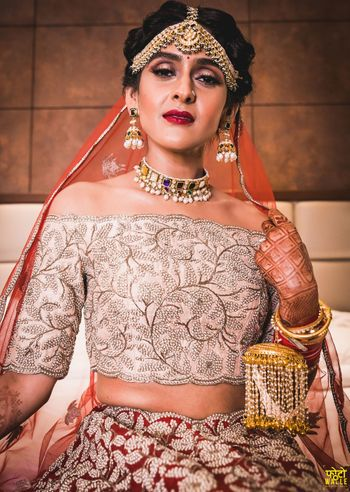 Modern bridal look with silver off shoulder blouse