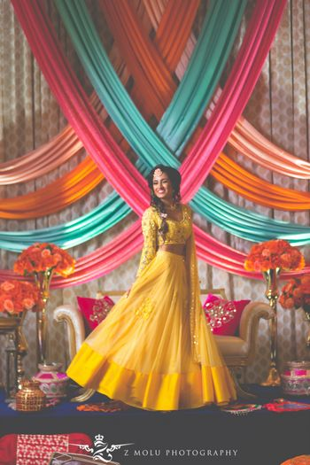 Happy bride with colourful draped backdrop