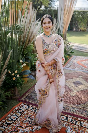 Bride dressed in an organza saree for her brunch.