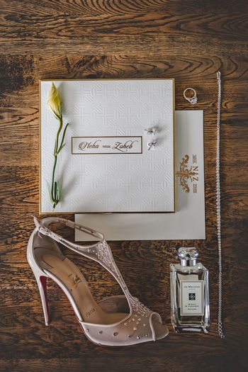 Photo of Bridal accessories with perfumes and heels