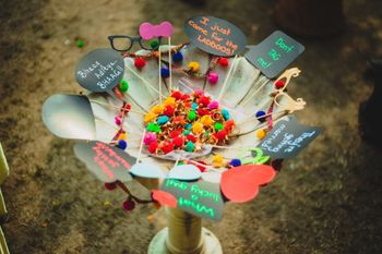 Photo of Pom poms and callouts for mehendi decor