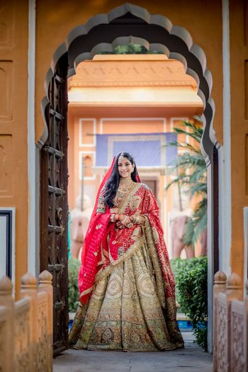 Bride wearing a heavy lehenga double dupattas.