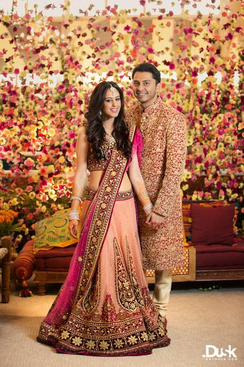 Floral backdrop with indian bride and groom