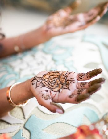 Minimal bridal rose mehendi design