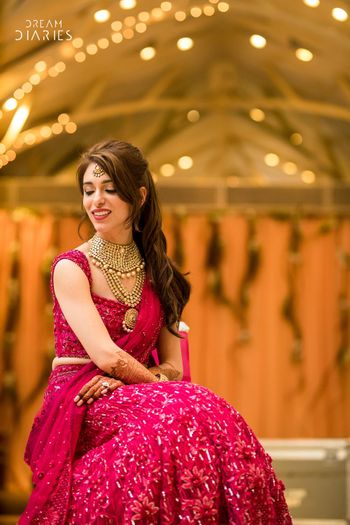 Photo of Bridal portrait in red sangeet outfit
