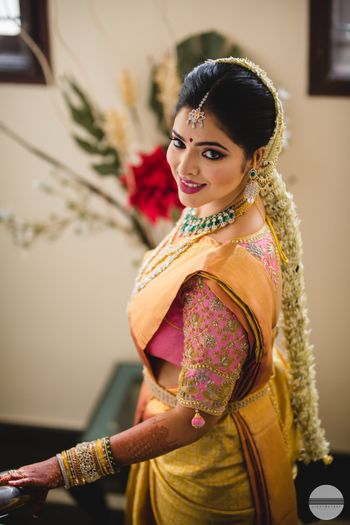 Photo of South Indian bridal look with gold kanjivaram and pink blouse