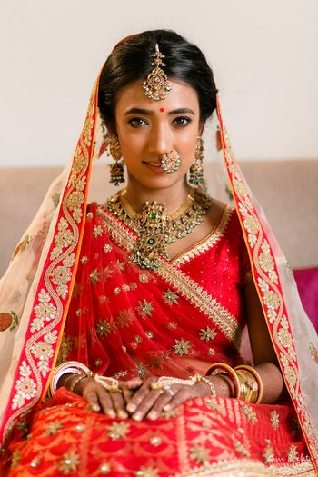 Bride in Bright Red Lehenga and Contrasting Jewellery