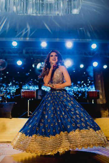 Happy bride dancing on sangeet shot