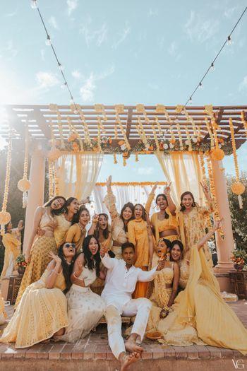 fun haldi photo with everyone in yellow