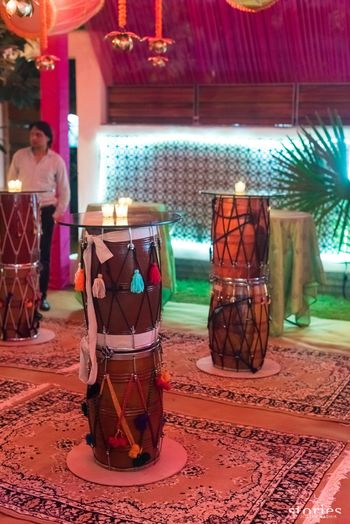 Mehendi decor idea with dhols as tables
