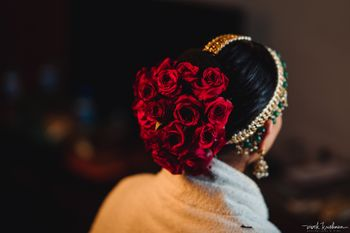 Red bridal bun with a lot of roses
