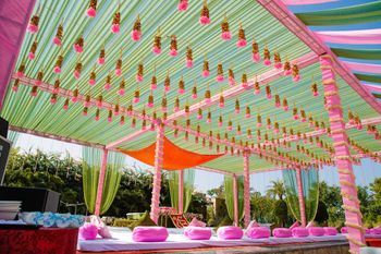 Photo of Pink and green theme decor with hanging tassels