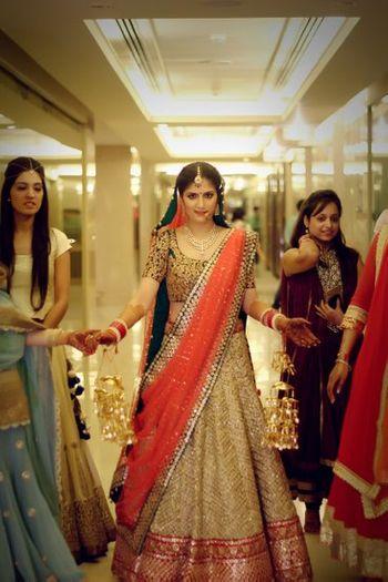 Gold bridal lehenga from Sudhir Bhai Saree Sangam