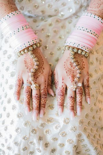 Photo of Unique light pink Chura for bride