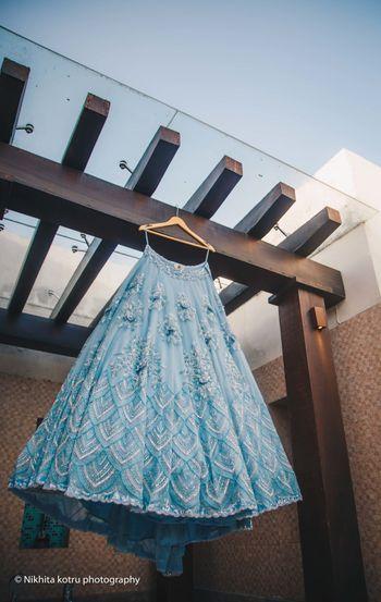 Photo of Light blue engagement lehenga on hanger