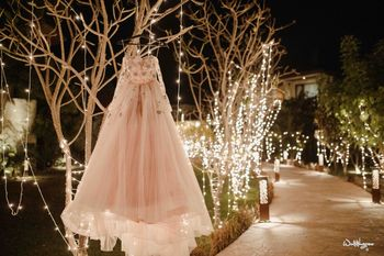 Photo of reception gown on hanger at venue