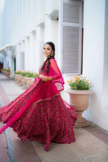 Bright pink mehendi lehenga for the bride