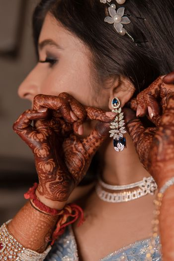 sangeet or reception bridal earrings with sapphire and diamonds