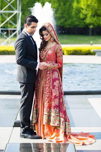 Muslim Bride in Red and Orange Jacket and Lehenga Skirt