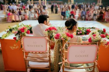 Cute personalised decor idea with bride and groom chairs